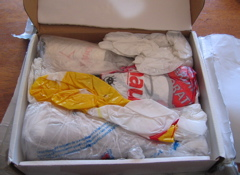 Lots of plastic bags stuffed into a box